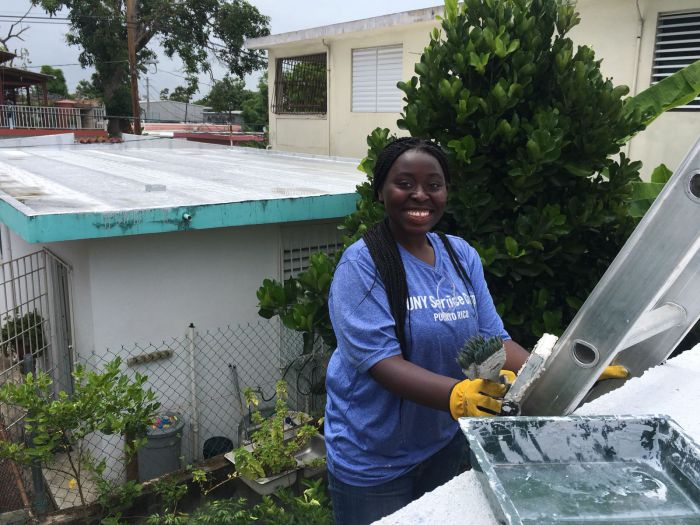 Alexis Augustine, helping to fix a homeowner's roof