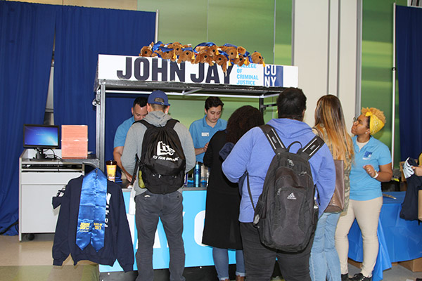 Students purchasing John Jay College merchandise at Jay Cart