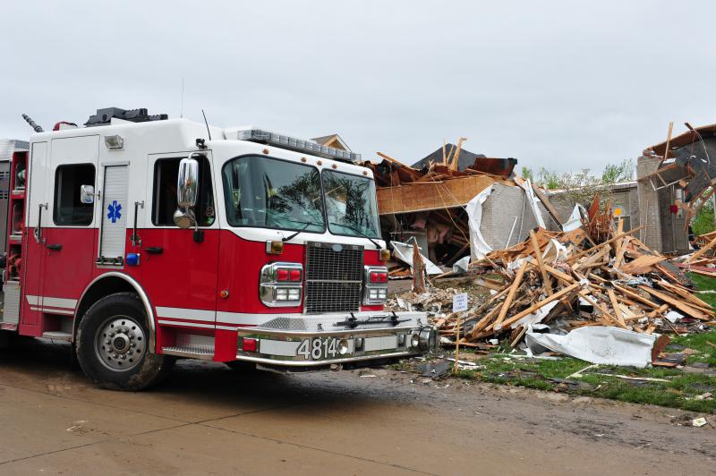 Fire truck at a destroyed house