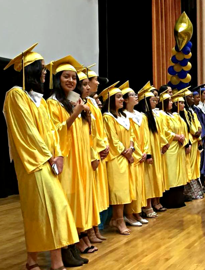 Students in graduate gowns