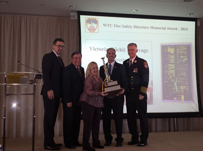 Victoria Pitcavage, Director of Fire Science Institute, receiving the WTC Memorial Award with Daniel Nigro, FDNY Commissioner, Jack Murphy, FSDA Chairman, Russell Touhey, FSDA President, and Edwards Kilduff, FDNY Chief of Department.