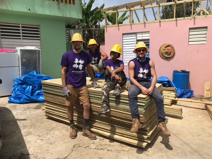 Aaron and his teammates take a break from rebuilding a house