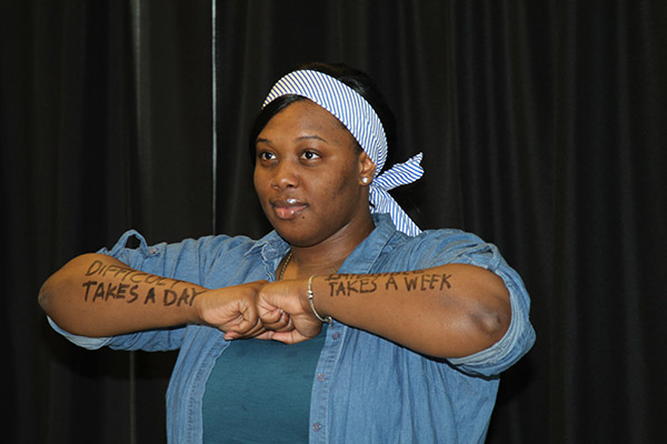 Student with inspirational words written on her arms