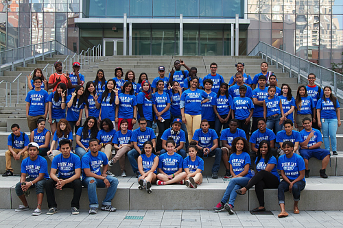 High schools pose for picture wearing blue john jay upward bound shirts